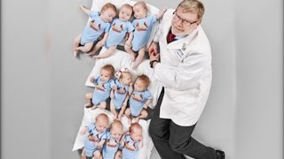 Doctor Poses With 3 Sets Of Triplets He Delivered Within 6 Weeks
