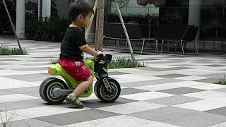 Kids bike and riders playing happily outdoors