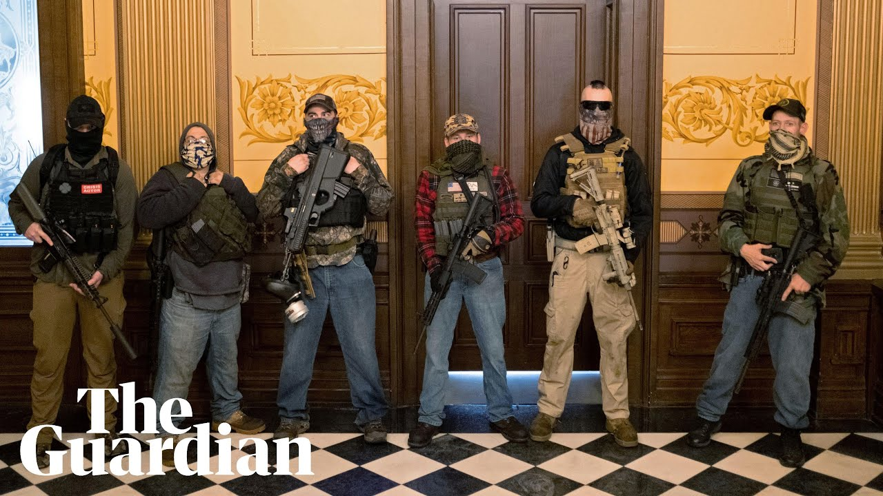 Armed protesters demonstrate against Covid-19 lockdown at Michigan capitol  | US news | The Guardian
