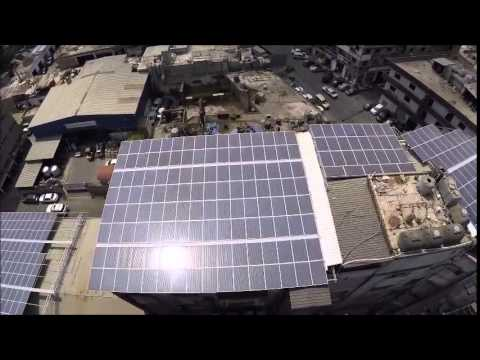 A Rooftop Solar Power Farm in Beirut - Aerial View from Drone.