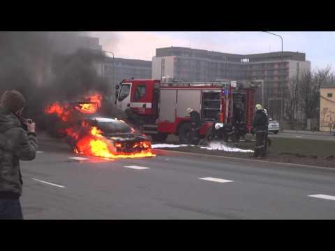 Car in fire. Latvian firemen at work.