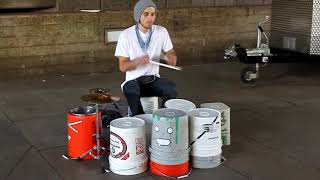Another GREAT Street drummer playing on buckets