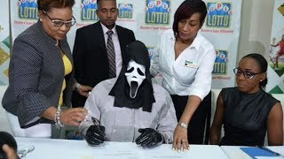 Lottery winner claims prize in Scream mask to hide identity