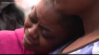 Candlelight vigil held for family killed in triple homicide