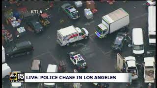 NOW: WILD DRIVER PLOWS INTO STREET MARKET! POLICE CHASE UHAUL TRUCK IN LOS ANGELES