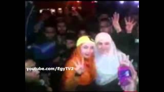 بالفيديو زوجة دكتور مرسي ودكتور هشام قنديل فى مسيرة الشرعية بستة اكتوبر