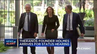 Theranos founder Elizabeth Holmes arrives for a pre-trial hearing