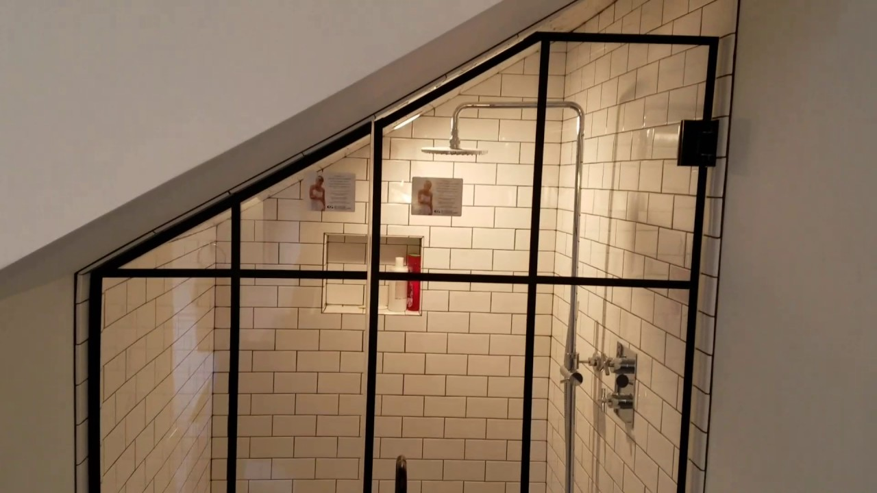 Custom Frameless Glass Shower Enclosure with Matte Black hardware by ...