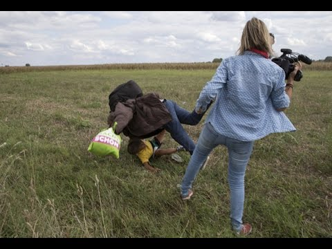 Camerawoman Caught Tripping Syrian Refugee Carrying Child