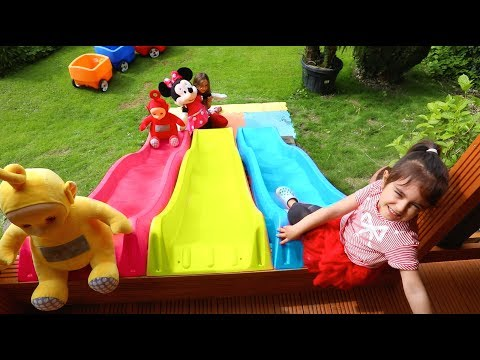Emily Having Fun on Slide - Teletubbies Wagon Ride