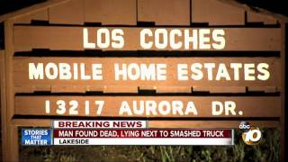 Man found dead, lying next to smashed truck