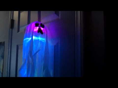 Gemmy haunted house under glass doovi for Animated floating ghost decoration