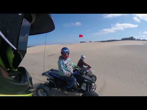 Throwing sand at Spinreel dunes Oregon Coast