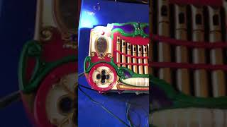 Opening Mr. Christmas Holiday Carousel for repair