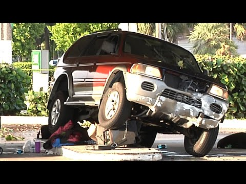 SUV Runs Over Woman And ATM At Bank In North Miami Beach, FL - Miami-Dade Fire Rescue Helps Woman
