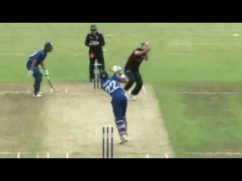 Canterbury bowler Andrew Ellis carries on after being hit on the head by the ball