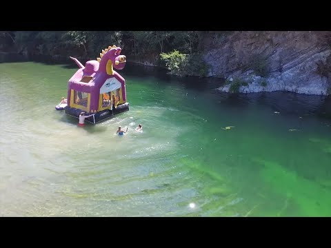 Thumbnail: Bounce House floating on a river