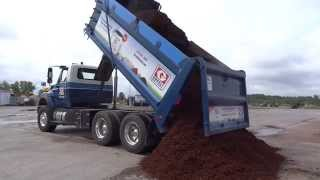 Greely Sand & Gravel unloading a full tandem load of mulch