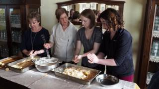 Girls making arancini's at the agritourismo in Italy. May 2017