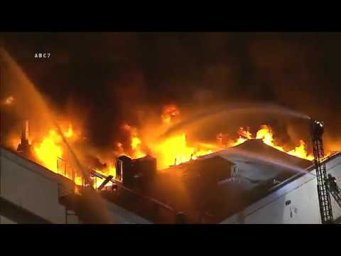Firefighters are battling a massive fire at a commercial building in South Los Angeles |firefighting