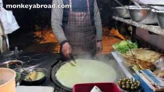 China Street Vendor Cooks A Pancake (jianbing)