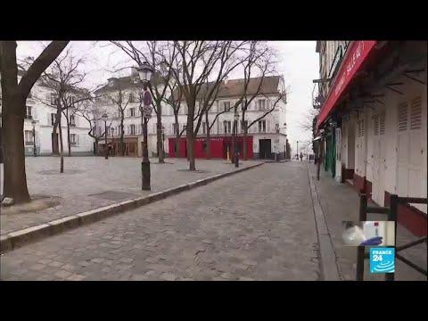 Coronavirus: peu de monde dehors à Paris, à l'exception des magasins