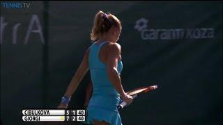 Camila Giorgi smashing racquet upset by an umpire error