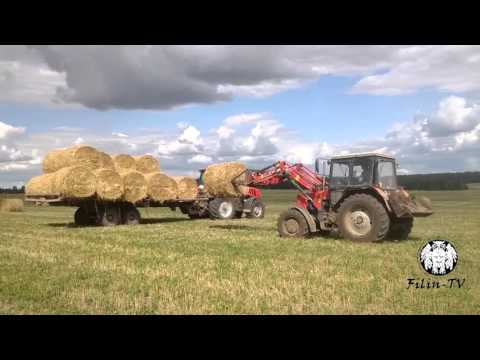 Сбор рулонов соломы в скирду. Collecting bales of straw in skyrda