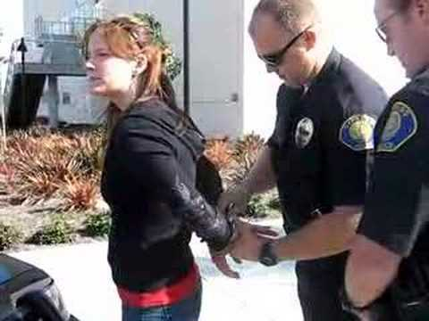 Woman arrested, handcuffed behind back