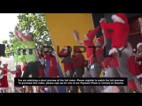 Denmark: Off-duty Santa Clauses Zumba in the summer