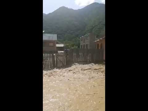 Georgia, Svaneti, Chuberi village, angry river in the center of settlement