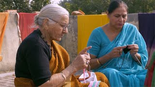 Shot of two old Indian women sitting on the terrace and knitting woolen clothes