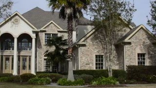 50 Forest Oaks Drive in English Turn Golf & Country Club