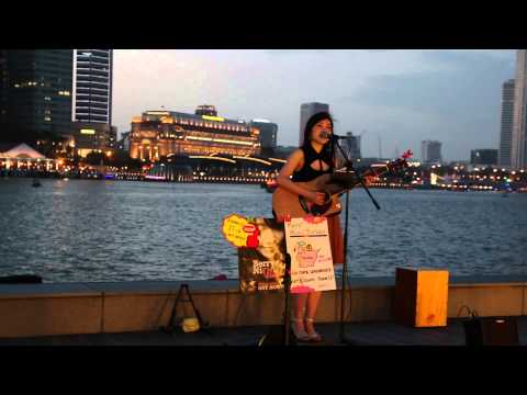 Singaporean girl singing in Chinese on the front of Marina Bay Sands
