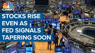 Stocks surge even as Fed signals taper may start soon