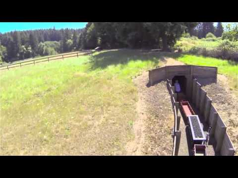 Man rides epic mini train network around his property