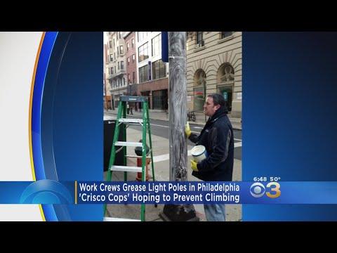 Work Crews Grease Light Poles In Philadelphia