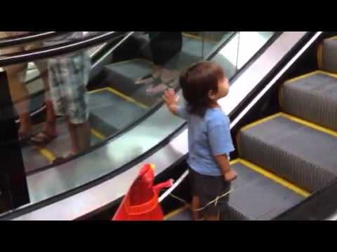 Baby Johnny 17.5 months waiting for the escalator