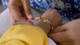 Raksha Bandhan - Shot of a girl tying rakhi to her brother on Indian festival