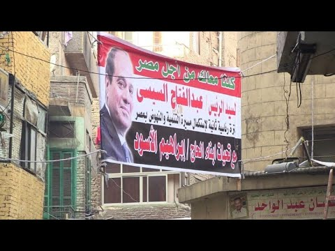 Cairo voters back native son Sisi despite economic woes