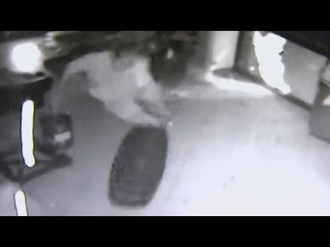 Man goes flying when tire smashes window