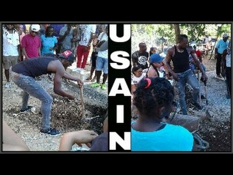 Usain Bolt helps to dig Germaine Mason's Grave in Portland Jamaica.