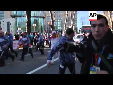 IOC President and UN chief carry Olympic torch through streets