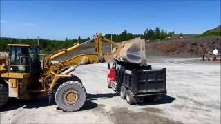 CAT 988 loading a dump truck