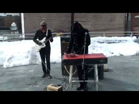 """Kigongo and Taylor Perform """"Walking With Jesus"""" On The Washington City Paper Parking Deck"""