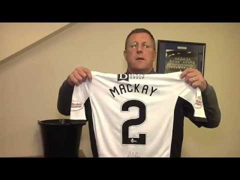Roddy Grant makes the draw to win the signed Dave Mackay shirt
