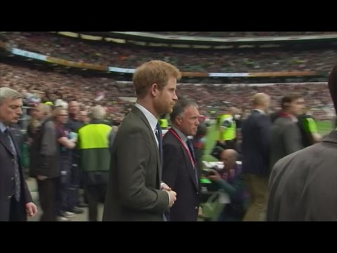 Former Army Captain Prince Harry steps out onto the rugby pitch for Army v Navy match