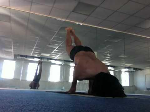 yoga headstand to peacock pose transition  sirsasana into