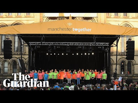 Choir lead Don't Look Back in Anger at mass singalong in Manchester