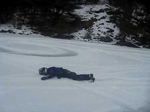 Hilarious Snowmobile Wipeout